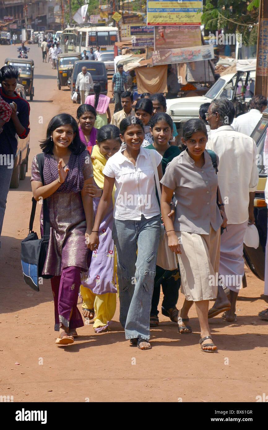 group of indian school girls walking on a street in delhi