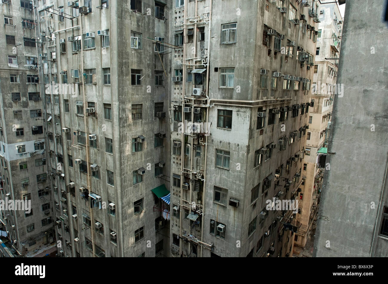 small old apartment building.  Old run down concrete high rise apartment buildings in Kowloon Hong Kong apartments close up at day Stock Photo Royalty