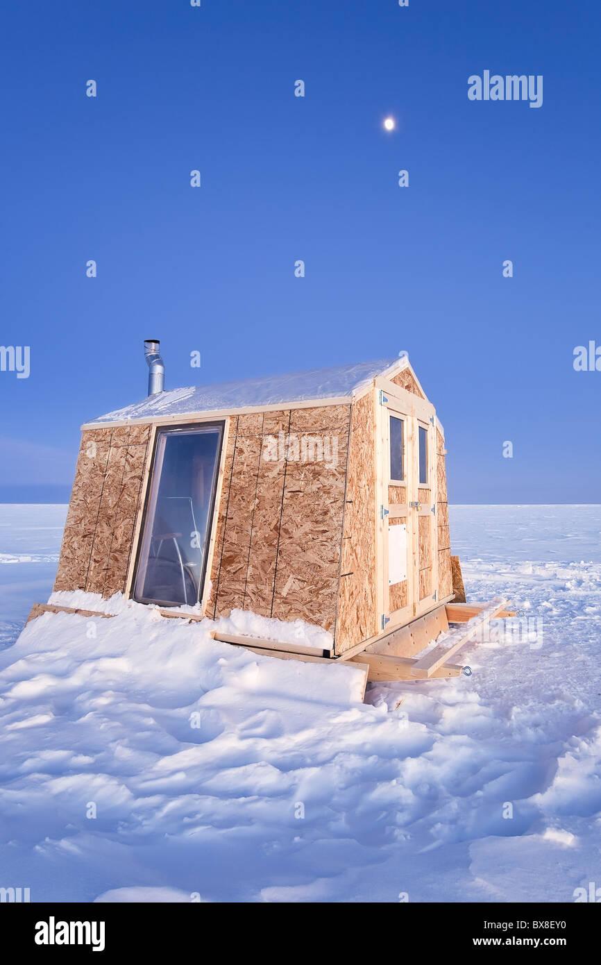 Ice fishing shack on moonlit night lake winnipeg gimli for Ice fishing at night