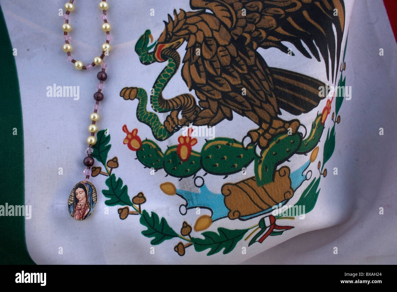 a mexican flag decorates an image of the our lady of guadalupe in