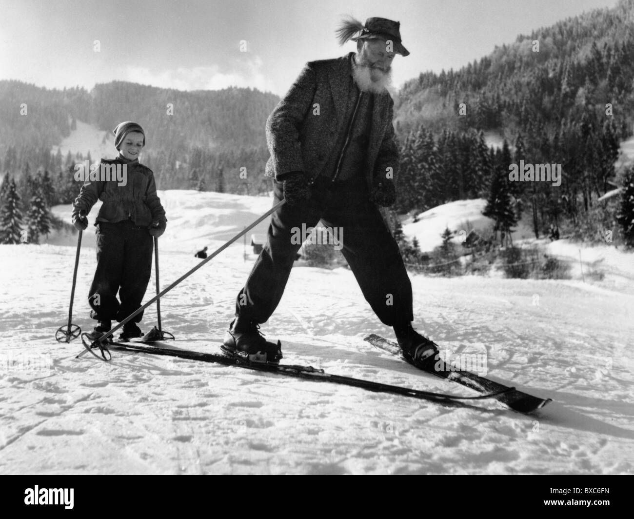sports winter sports skiing old man with child practice skiing stock photo royalty free. Black Bedroom Furniture Sets. Home Design Ideas
