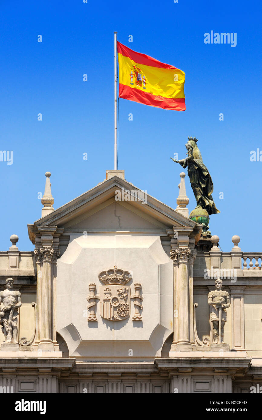 the spanish flag flying on top of a building in barcelona spain