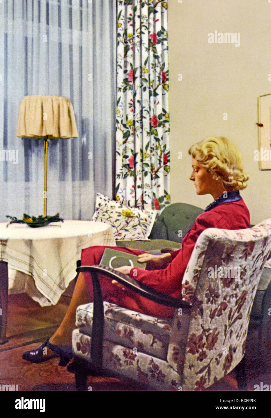 Living Room 1940s furnishings, woman sitting in living-room, advertising for stock
