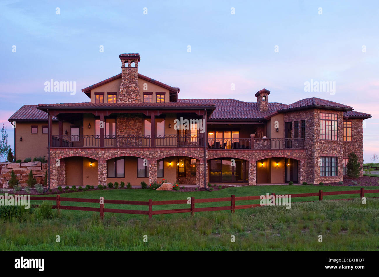Rear View Of Colorado Luxury Home At Sunrise Built By Brannen - Colorado luxury homes