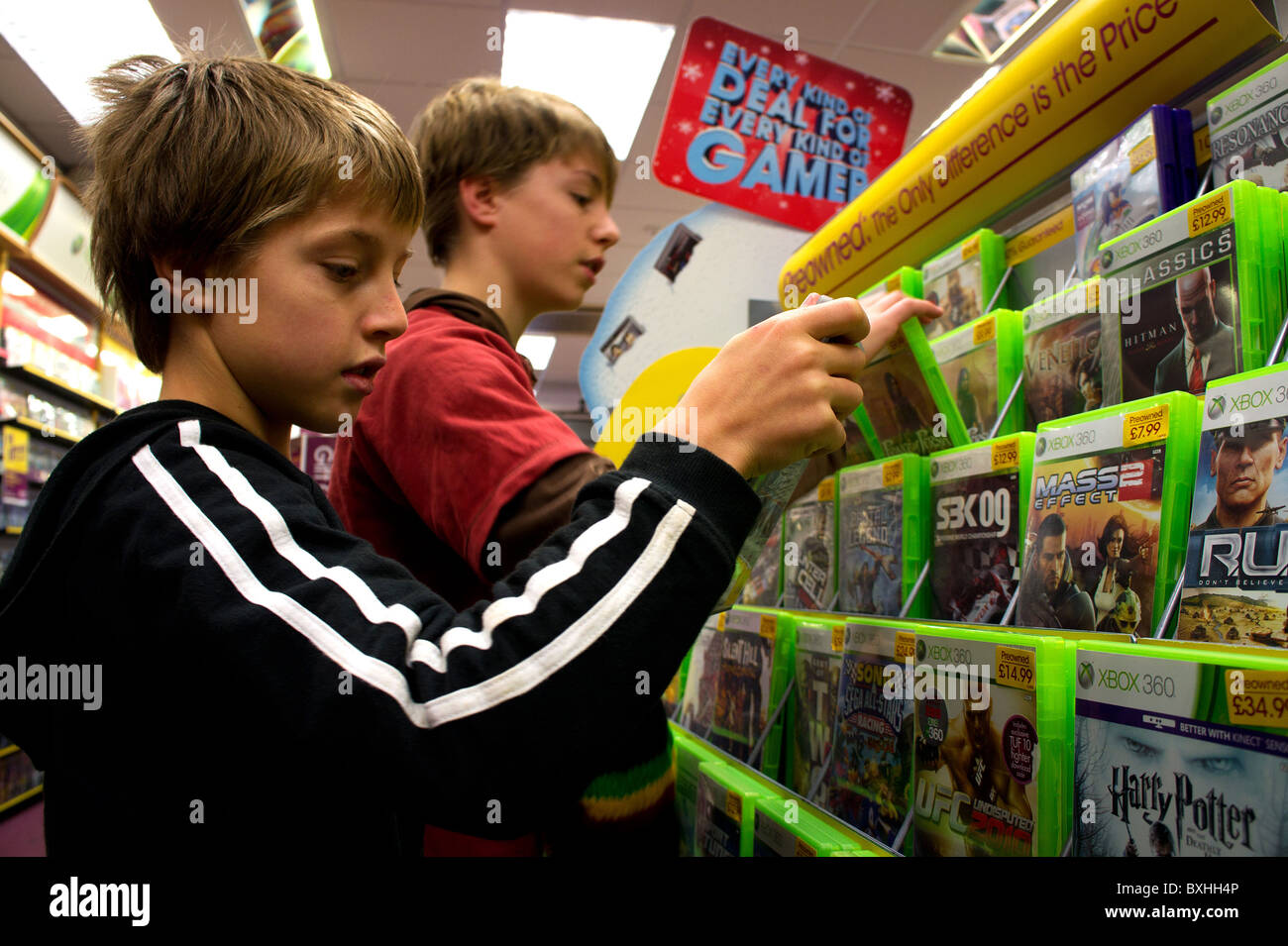 Stock Photo   two teenage boys looking at video games in a Game shop  UK. two teenage boys looking at video games in a Game shop  UK Stock