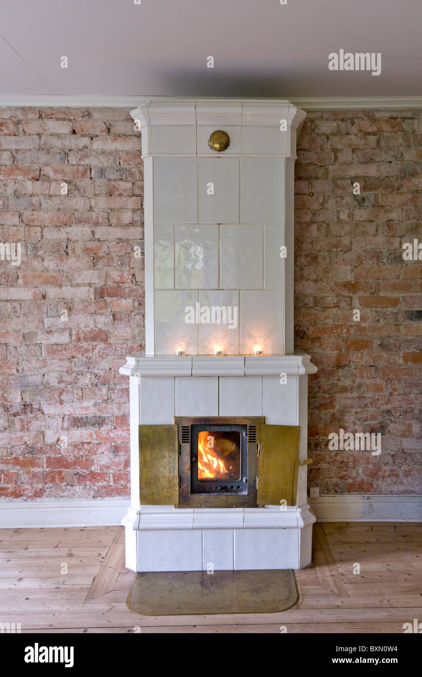 Modern ceramic tiled stove against brick wall stock photo modern ceramic tiled stove against brick wall dailygadgetfo Choice Image