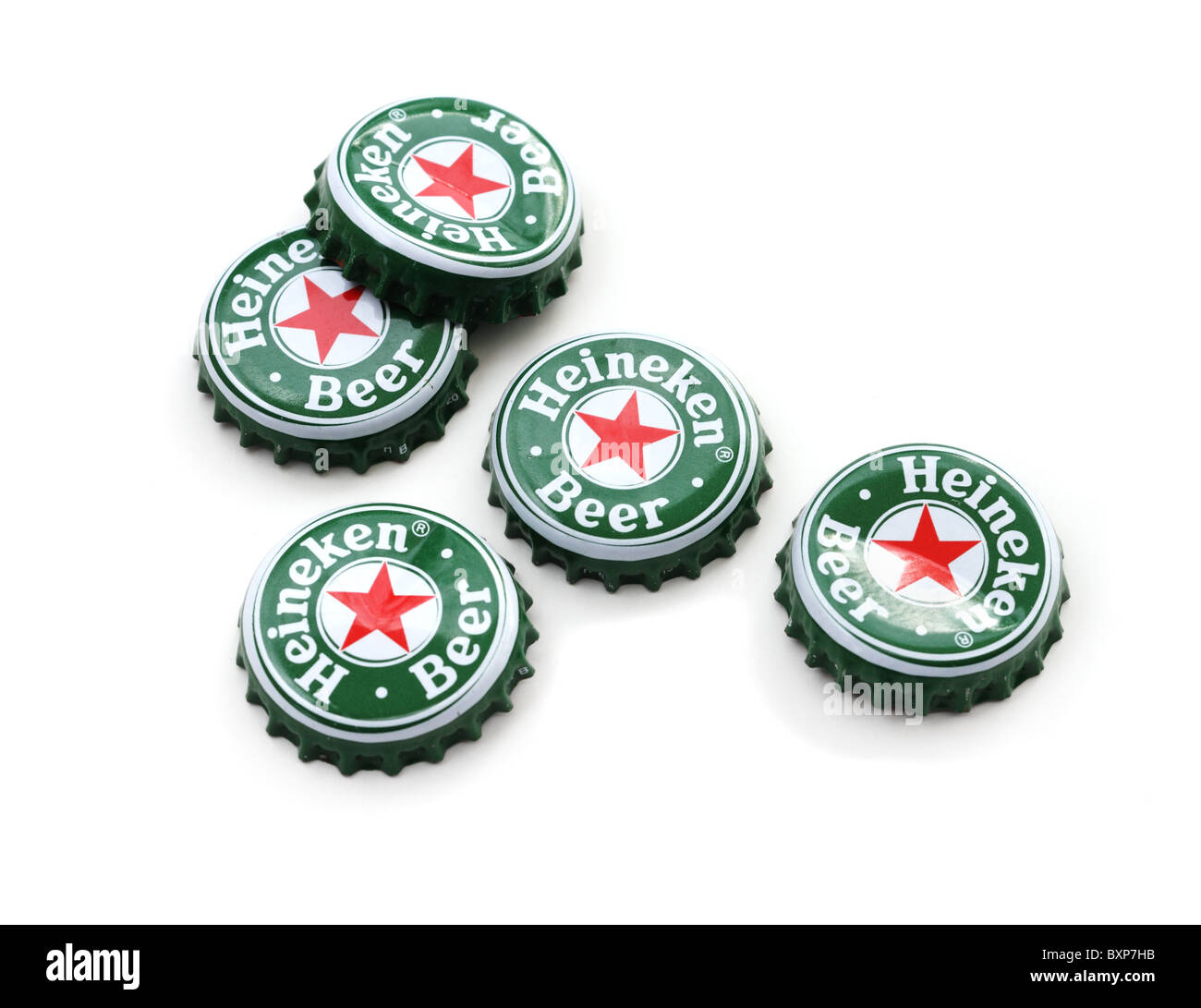 heineken beer bottle caps on white background stock photo