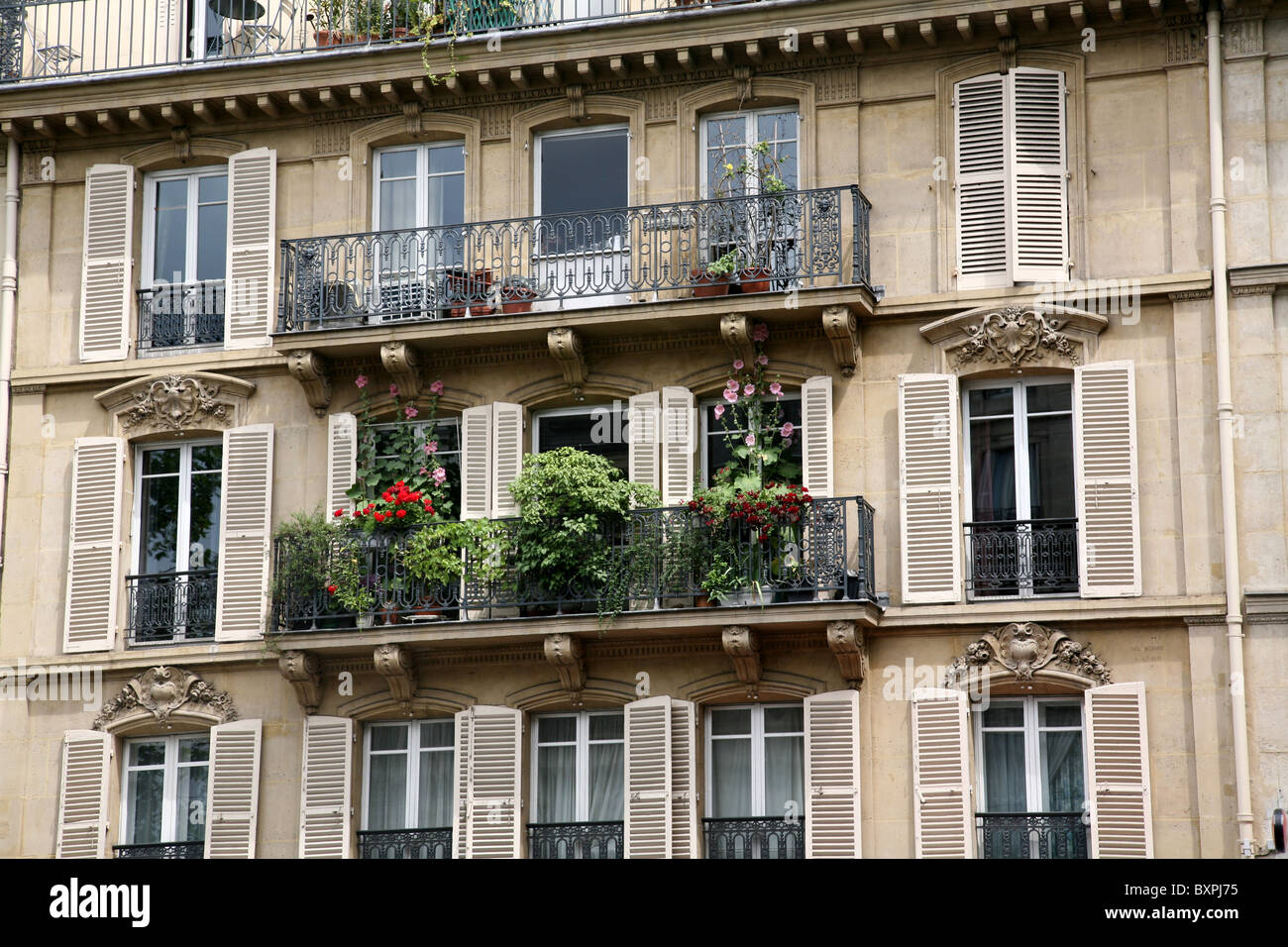 Paris apartment building balcony with flowers stock photo for Building balcony