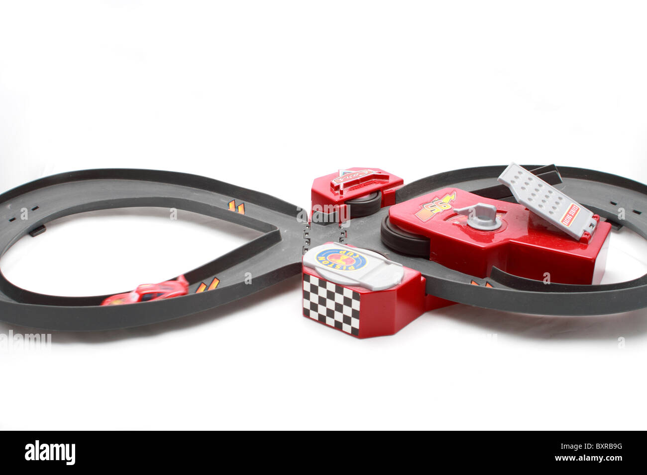 lightning mcqueen race car and battery powered racetrack toy based on stock photo royalty free. Black Bedroom Furniture Sets. Home Design Ideas
