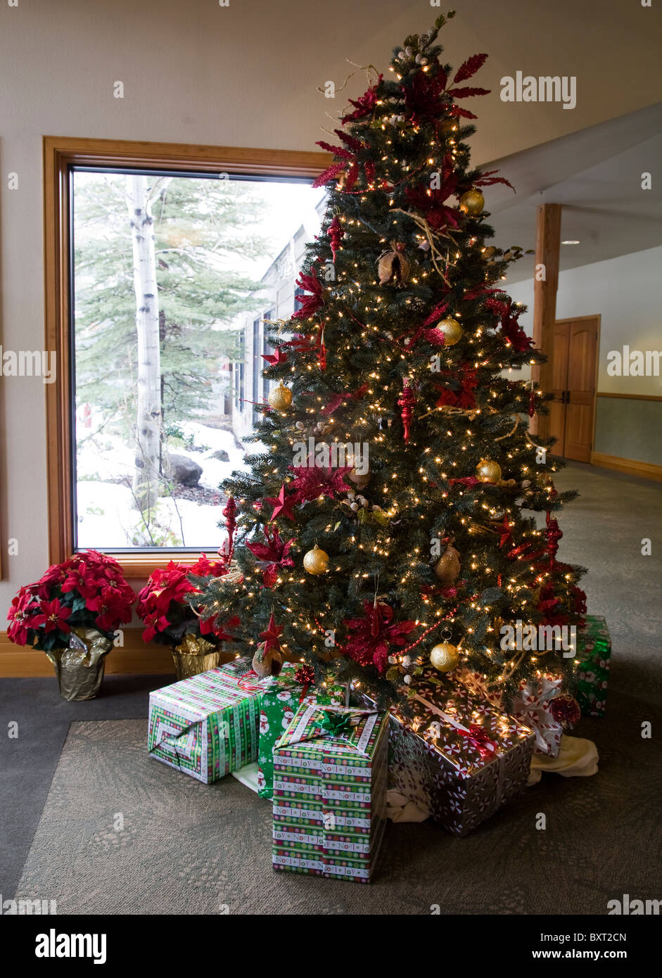 A christmas tree decorated with ornaments in a living room