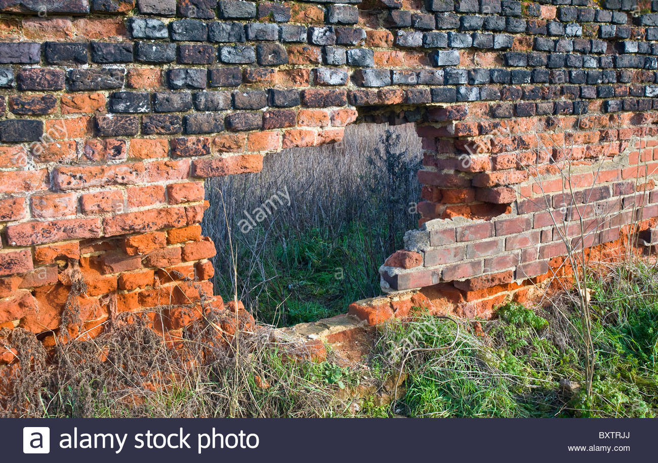 A Big Hole In Red Brick Wall