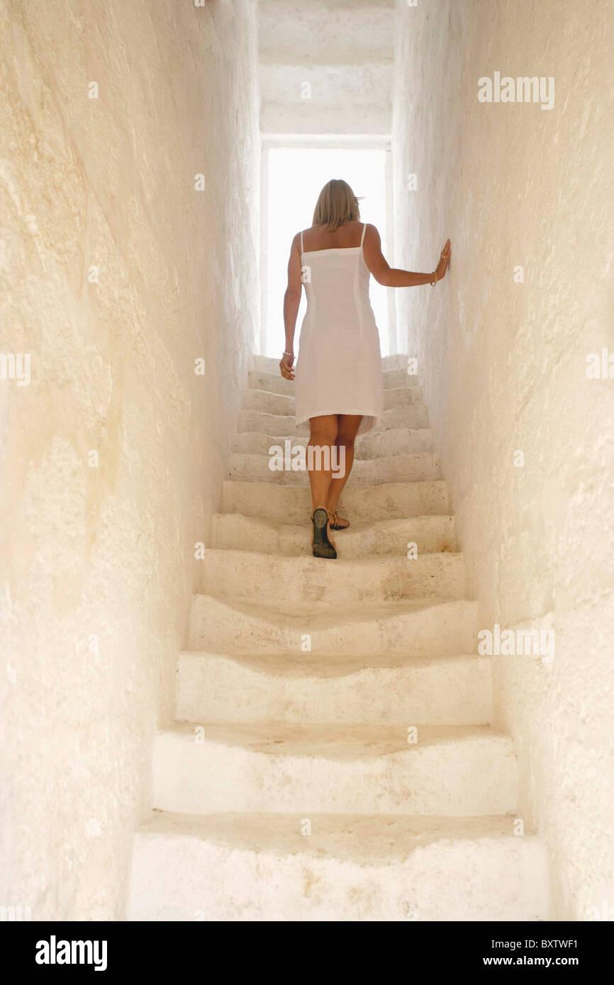 Beautiful Woman Ascending Whitewashed Stairs