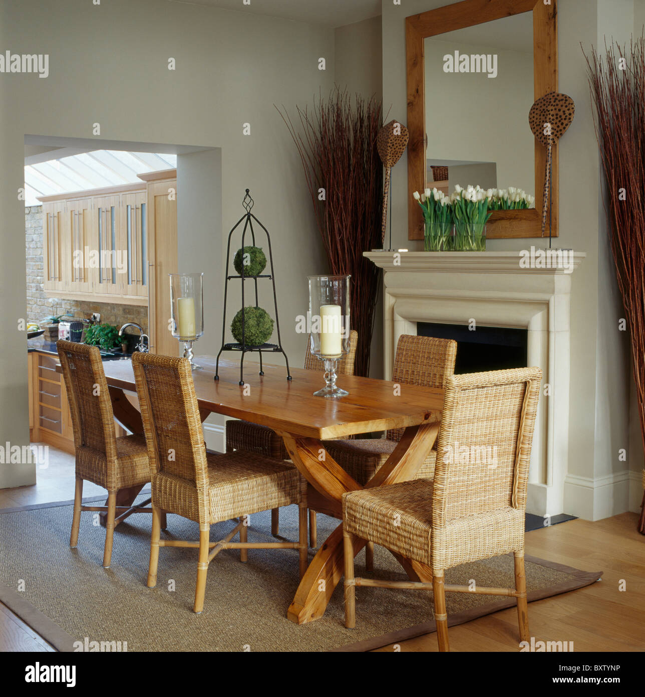 tall wicker chairs and plain wood table in pale gray townhouse