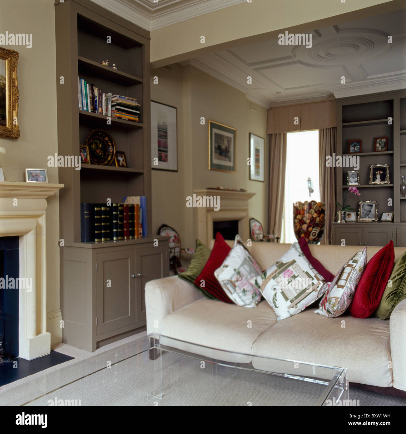 Patterned and plain velvet cushions on cream sofa in townhouse ...