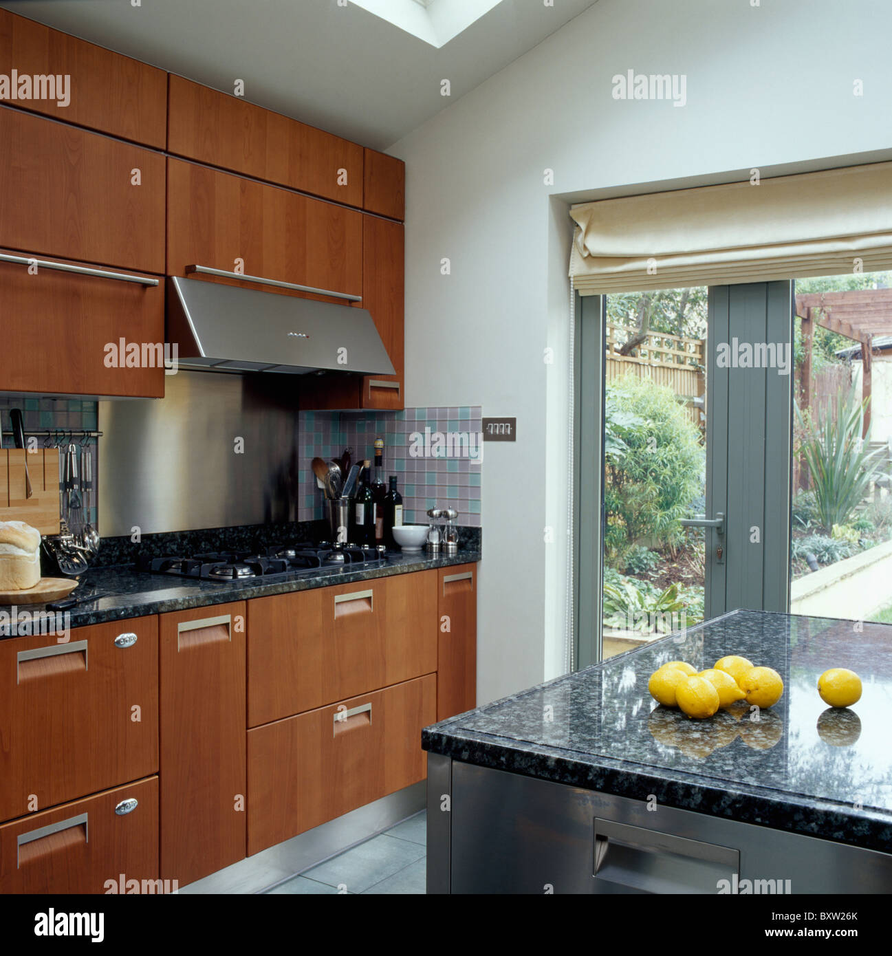 Kitchen Granite Worktop Chrome Extractor Above Hob In Granite Worktop Of Fitted Wood Unit