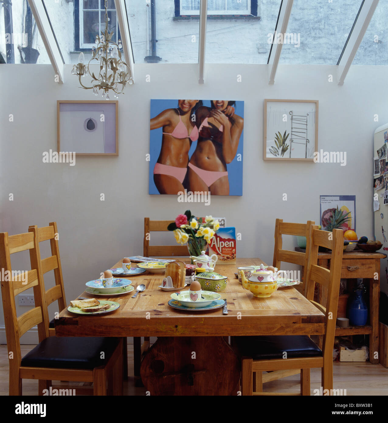 Large Picture Of Girls In Bikinis On Wall Small Dining Room Extension With Simple Pine Table Set For Breakfast
