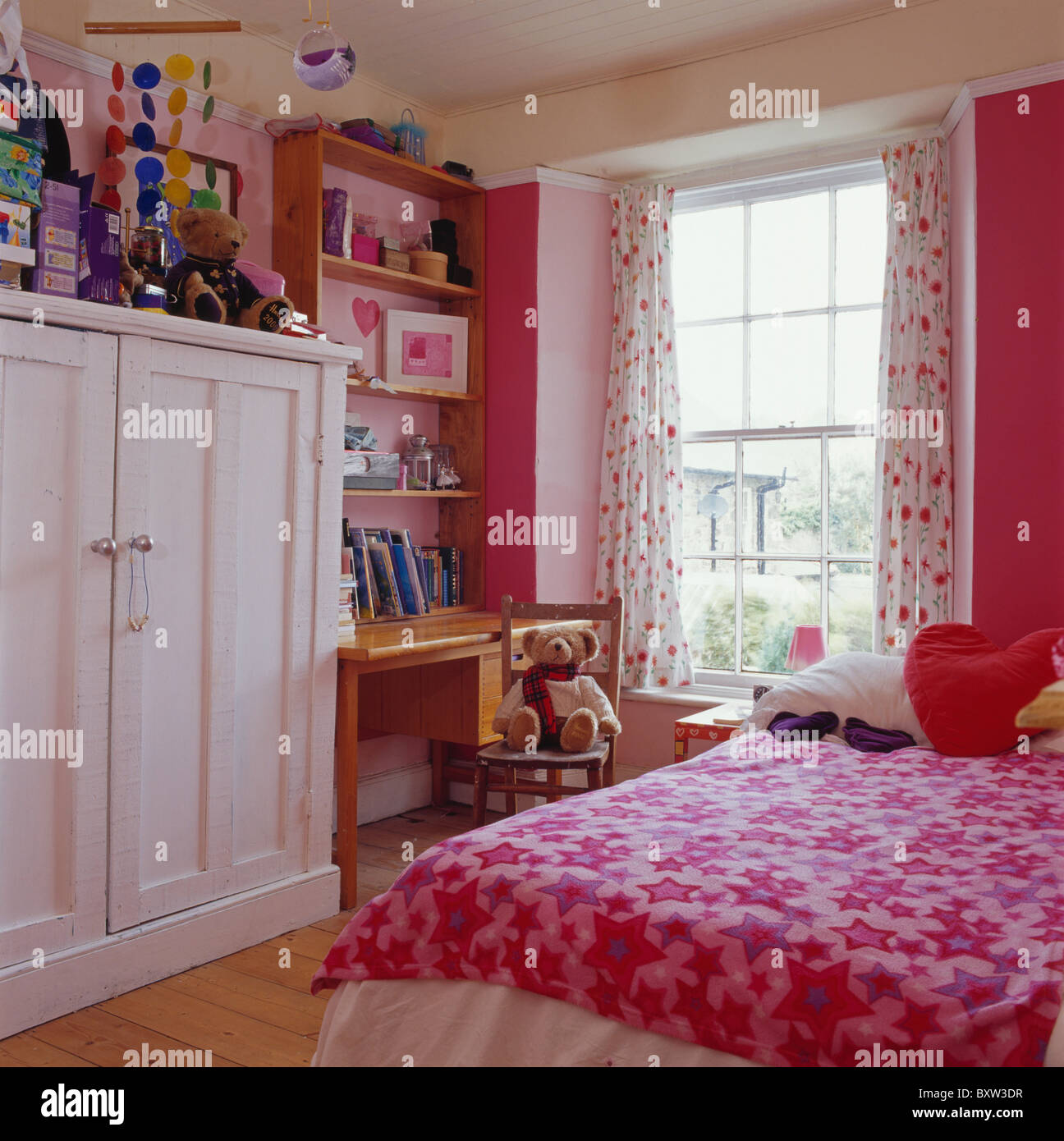 Stock Photo   White Painted Wardrobe In Childu0027s Pink+white Bedroom With Pink  Star Patterned Bed Cover On Bed