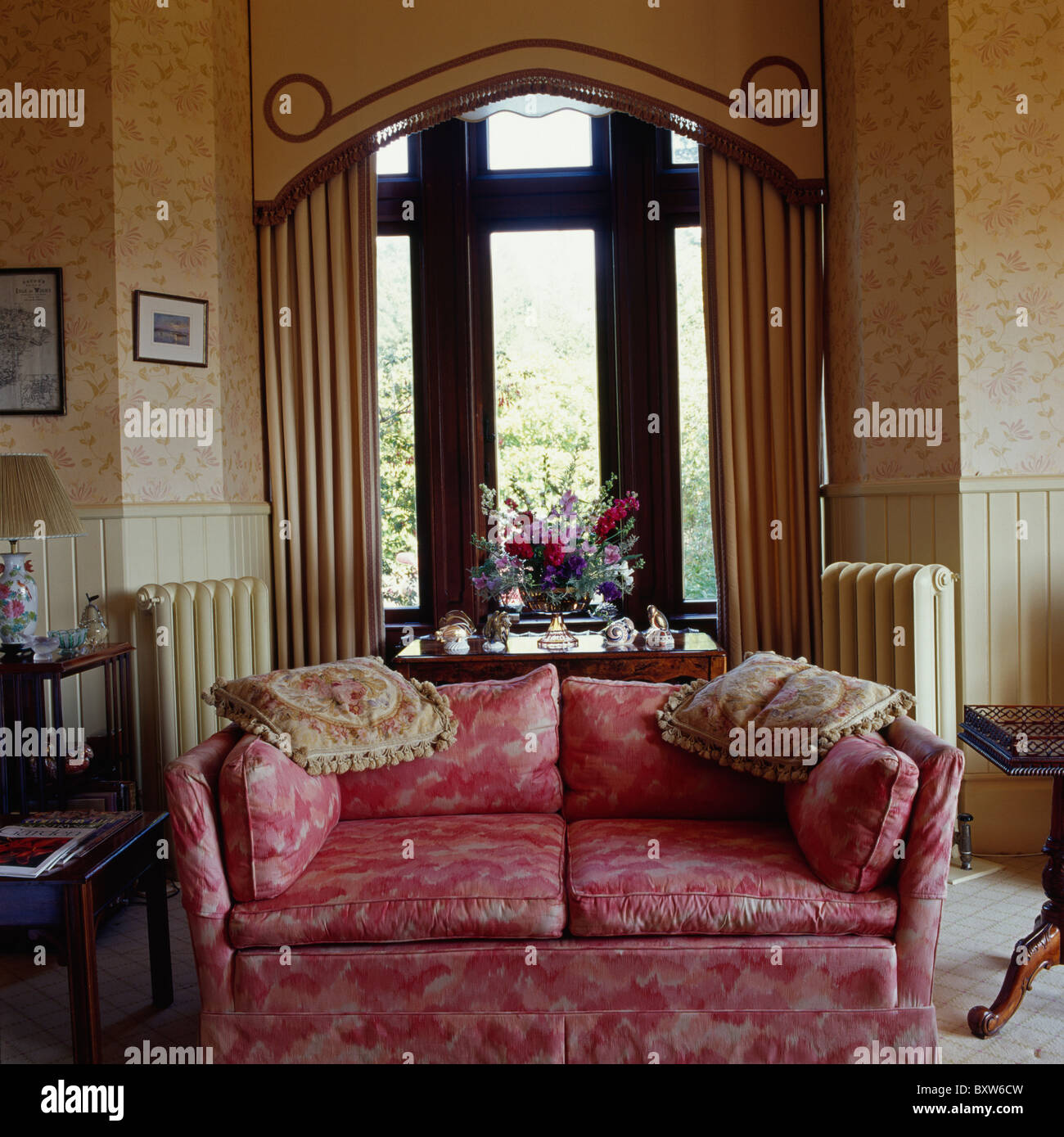 Patterned Red Sofa In Front Of Tall Window In Country