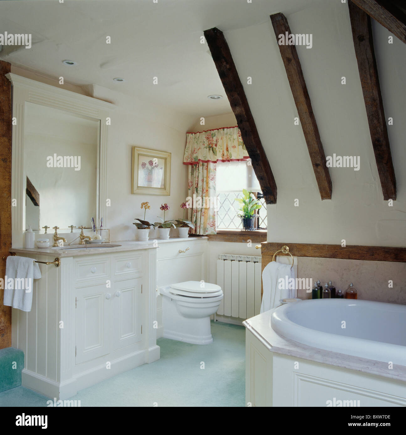Large Mirror Above Vanity Unit In Attic Bathroom With Pale Blue Carpet