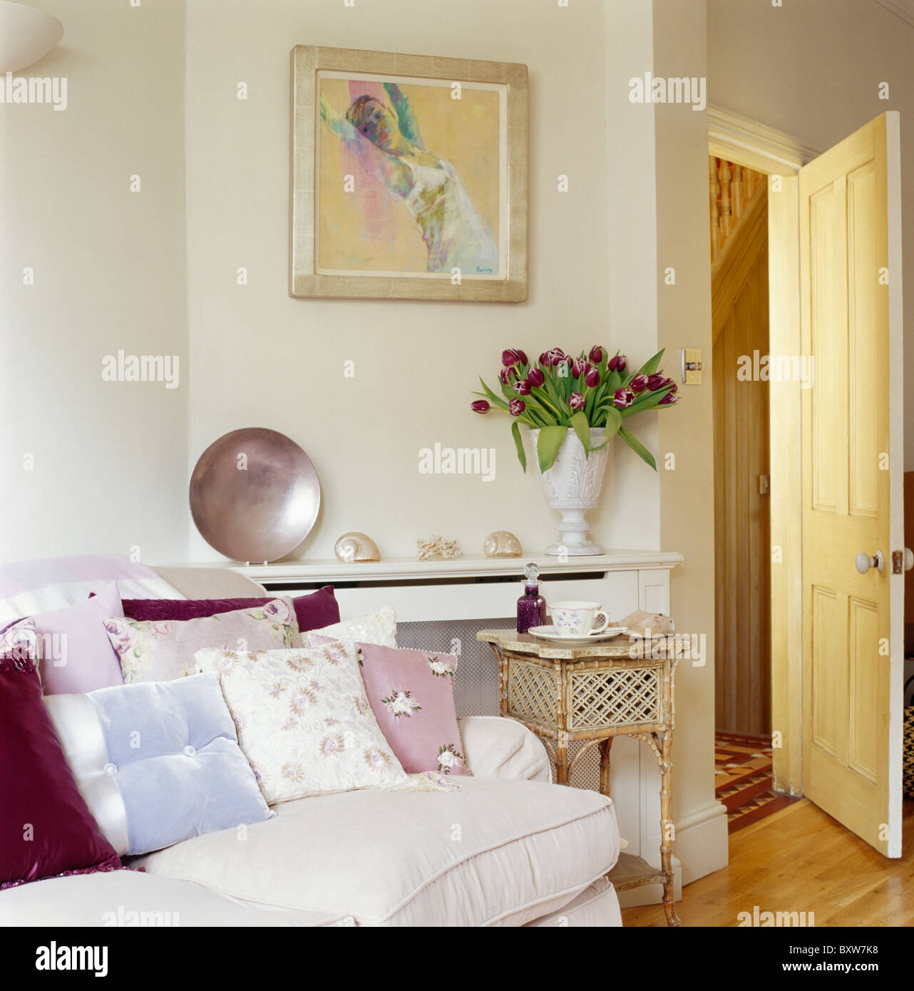Townhouse Living Room Pastel Cushions On Cream Sofa In Cream Townhouse Living Room With
