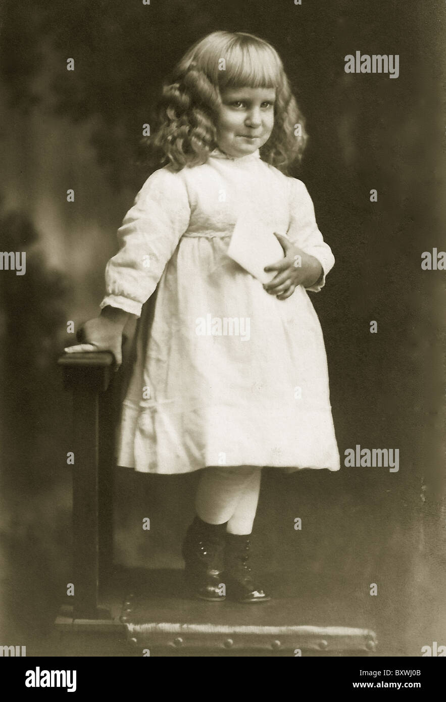 Antique Image Of A Little Boy With Long Curls Wearing A