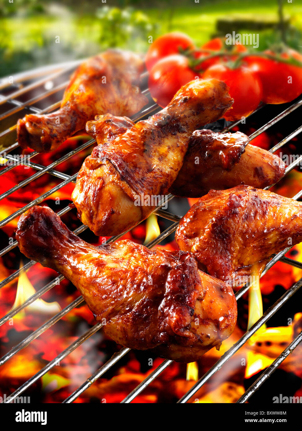 Barbecue chicken legs & thighs on a BBQ grill Stock Photo, Royalty ...