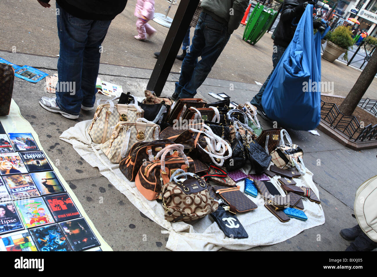 Counterfeit fake designer handbags on sale on sidewalk in new york city 2010 stock