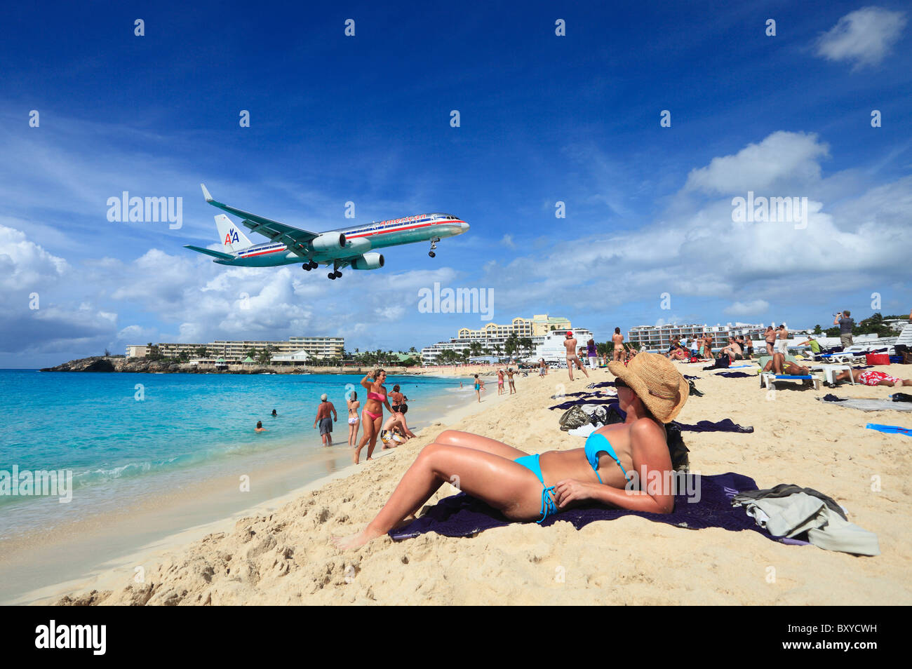 american airlines jet landing across the beach at st maarten princess stock photo royalty free. Black Bedroom Furniture Sets. Home Design Ideas