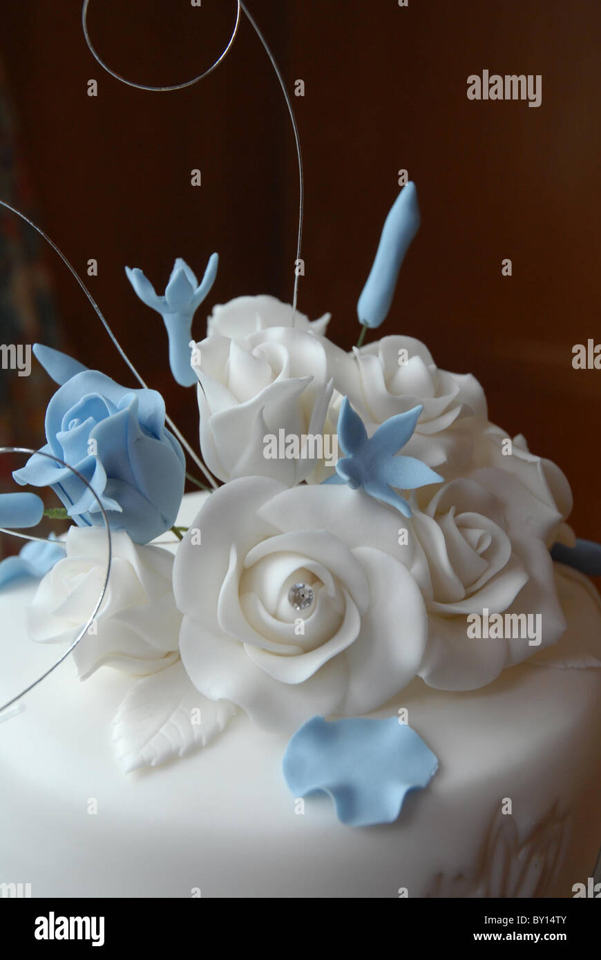 General Close Up Of A Wedding Cake Topper Baby Blue And White Roses Made From Icing On At Reception