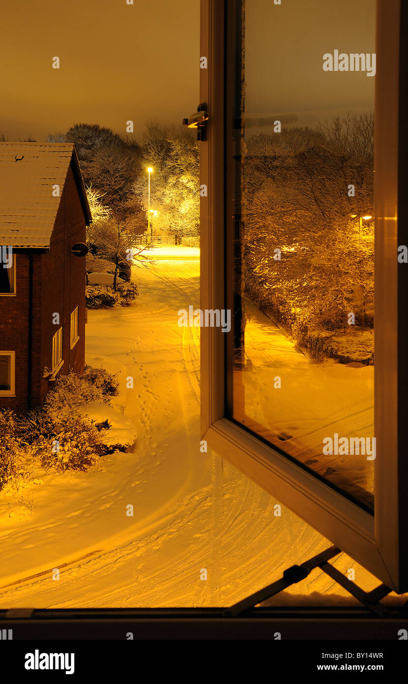 Open window at night - Stock Photo Night Time View Of Snow Covered Road Through Open Window
