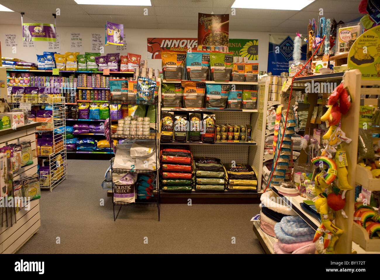 pet store interior stocked with food and toys for animals