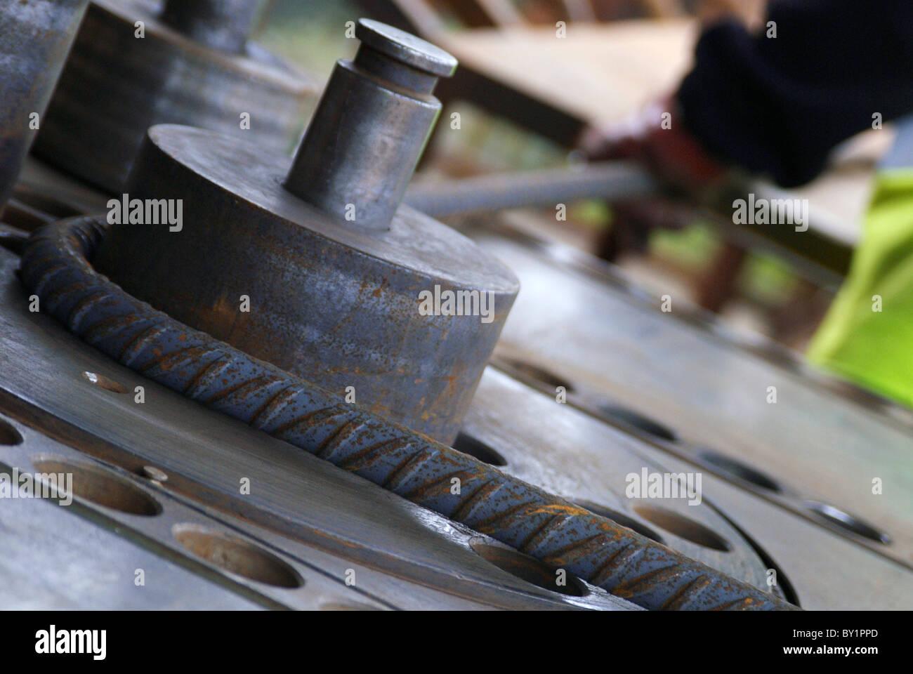 concrete reinforcement steel rebar cut and bent factory worker bending steel rods stock photo rebar worker