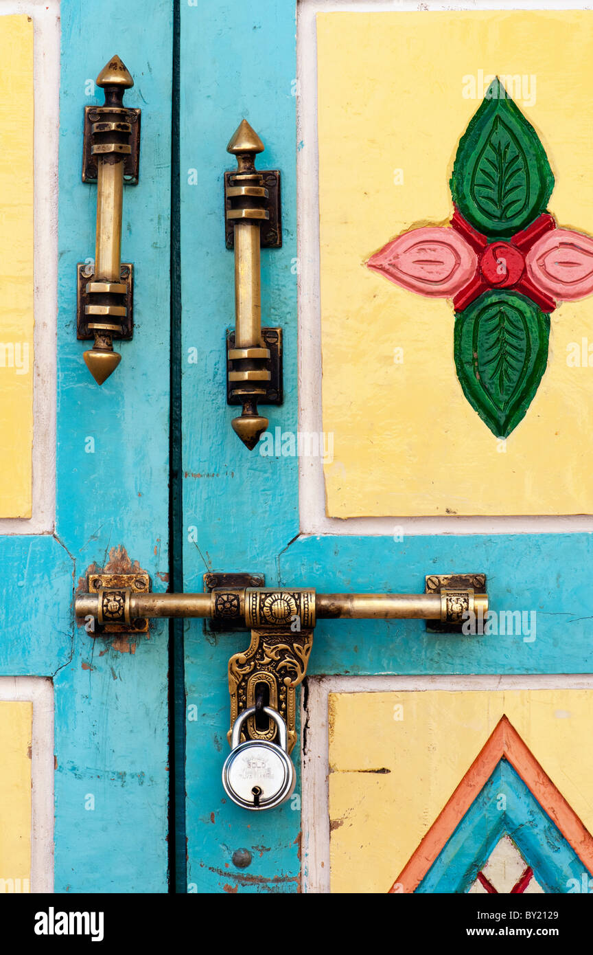 old indian colourful door with ornate handles and lock