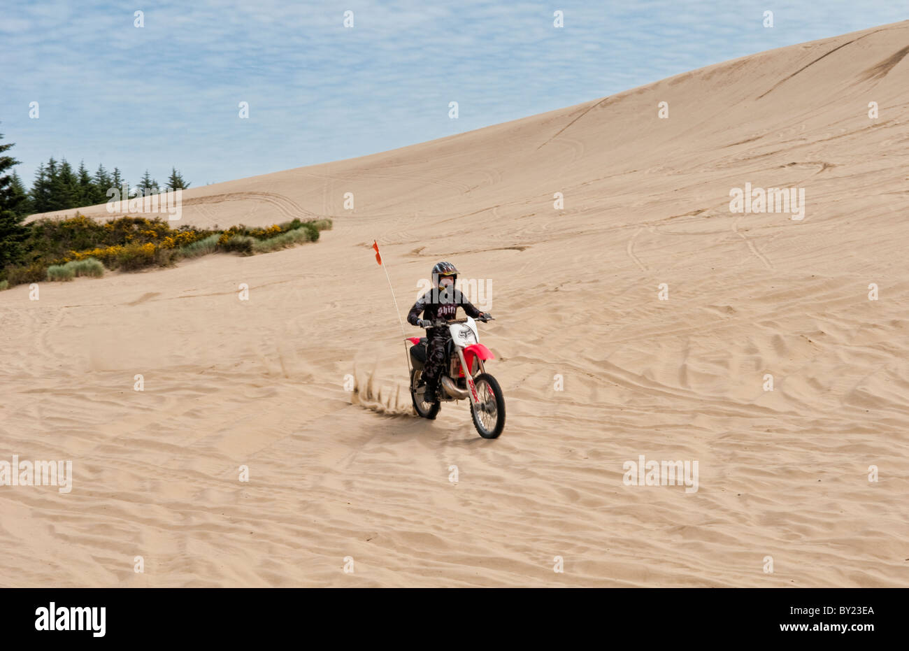 Teens Riding Dirt Bikes All Over The Massive Sand Dunes In Oregon