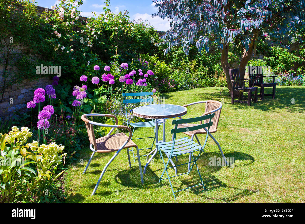 Summer Table And Chairs Part - 34: Stock Photo - Table And Chairs On The Lawn In A Walled English Country  Summer Garden