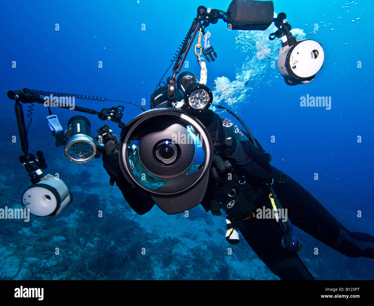 Diver with large underwater camera rig with strobes Stock Photo ...