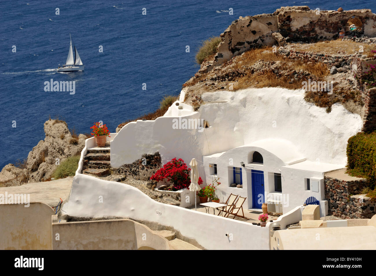 house built into the cliff face overlooking the caldera on the greek stock photo royalty free. Black Bedroom Furniture Sets. Home Design Ideas