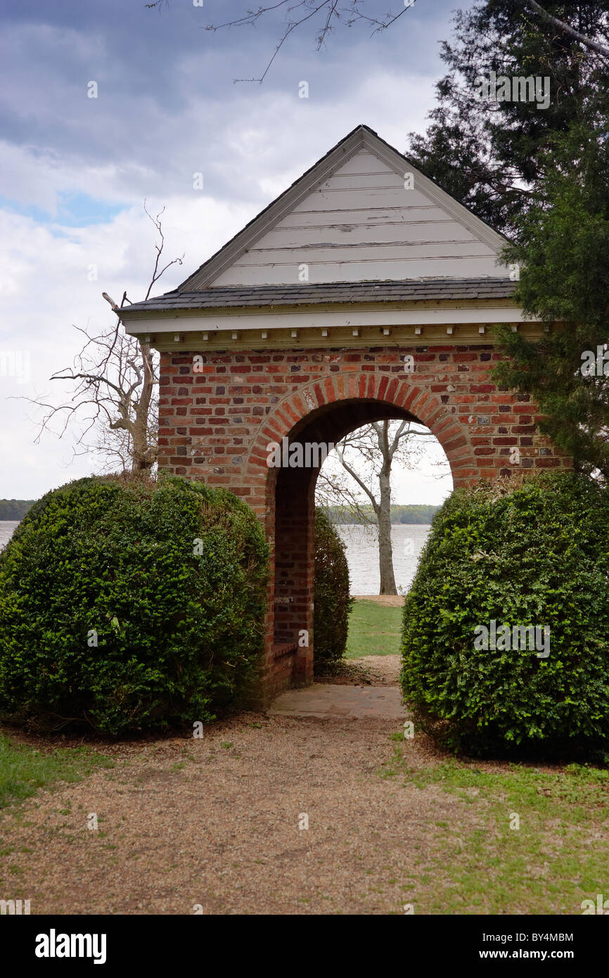 The Arch Of A Brick Pavilion In A Formal Garden Frames A Tree On The James  River, Virginia