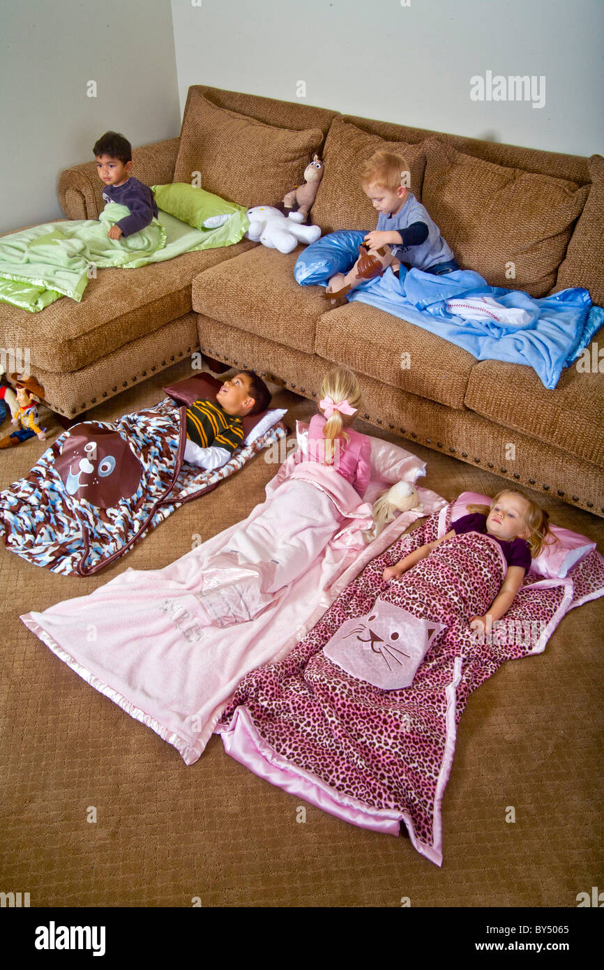 Children Bed Down For A Sleepover In Special Junior Size Sleeping Bags Southern California MODEL RELEASE