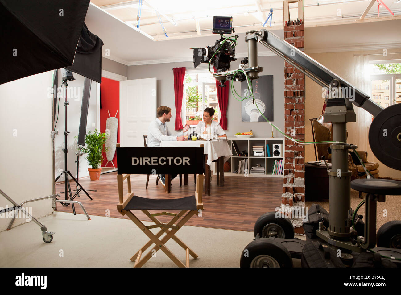 Actors Performing A Scene On A Film Set Stock Photo