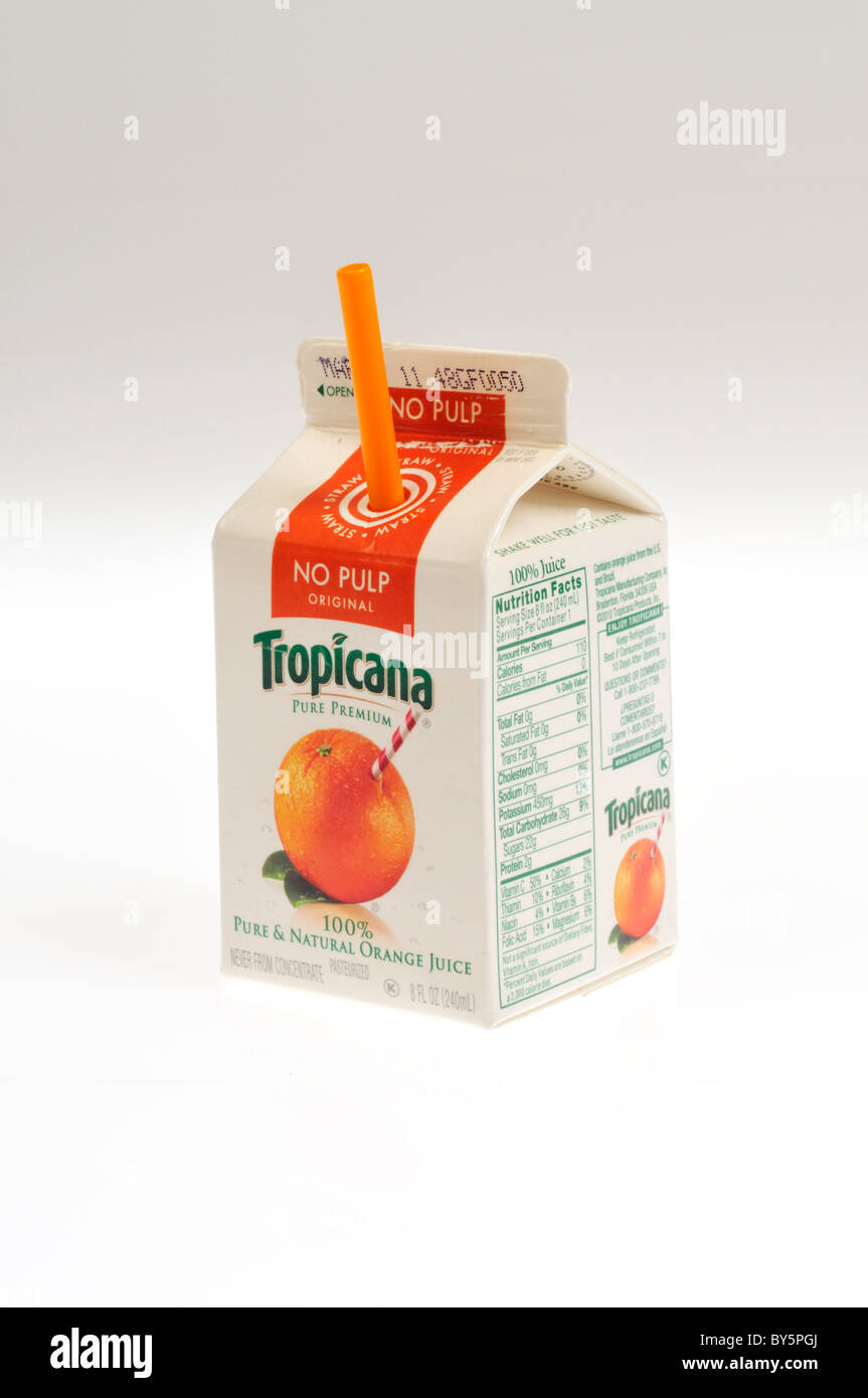 Single small carton of Tropicana orange juice with a straw ...