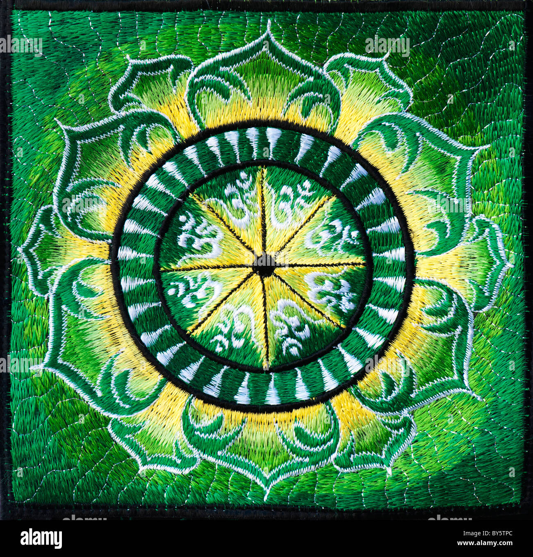 Multicoloured hindu om aum and lotus flower embroidery pattern indian handicraft multicoloured hindu om aum and lotus flower embroidery pattern indian handicraft stock photo dhlflorist Gallery