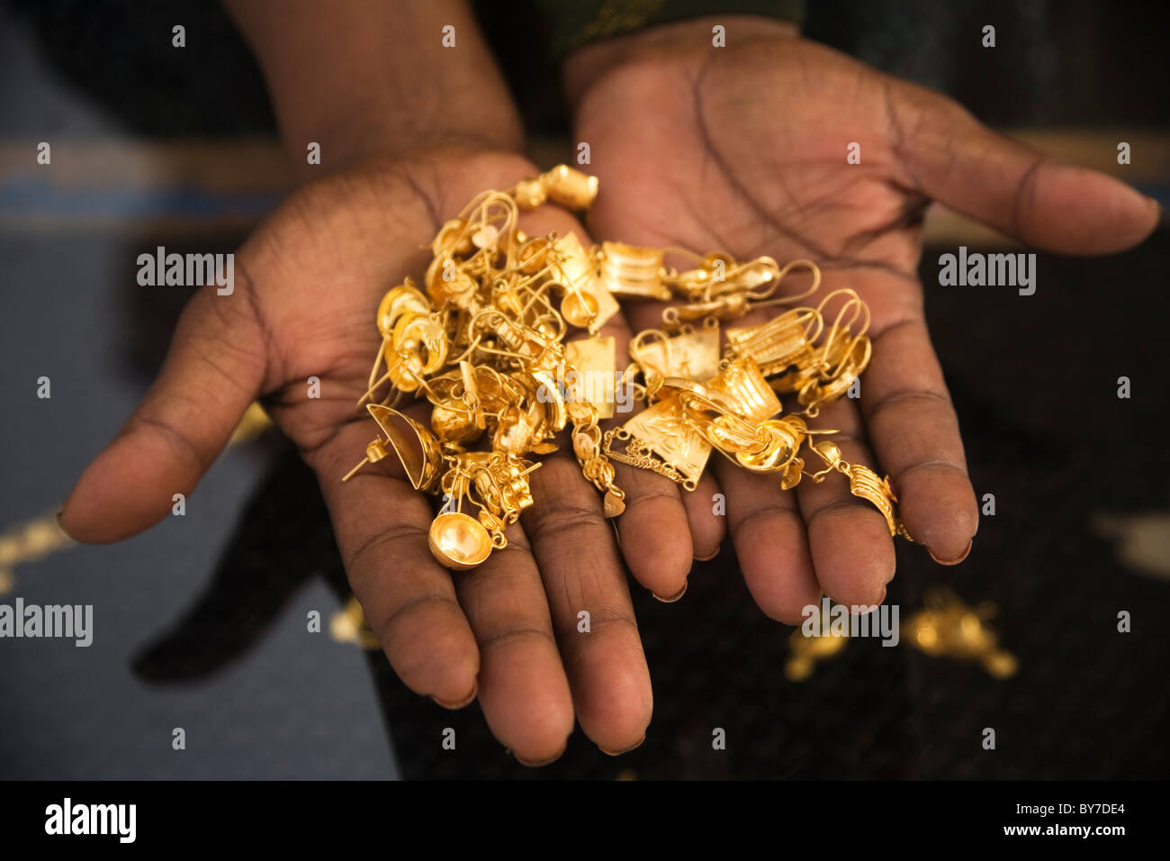 Somali Woman Trader Holds Gold Jewelery At Hargeysa Market