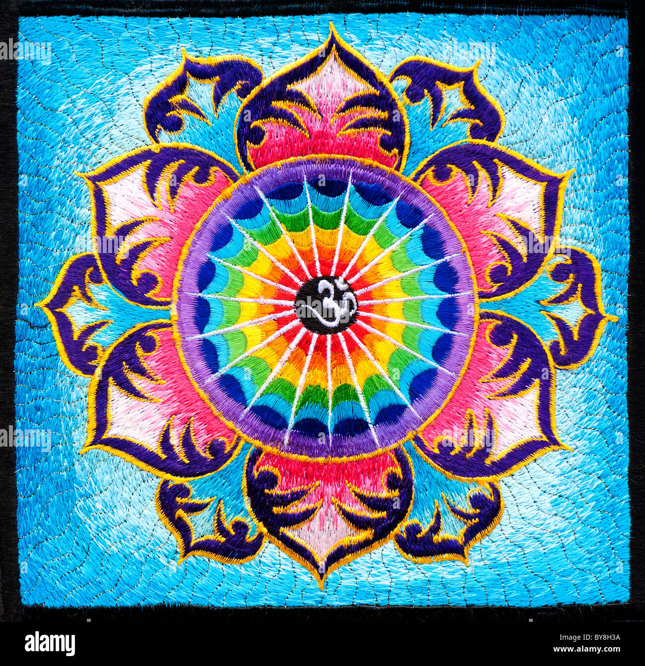 multicoloured hindu om / aum and lotus flower embroidery pattern, Beautiful flower