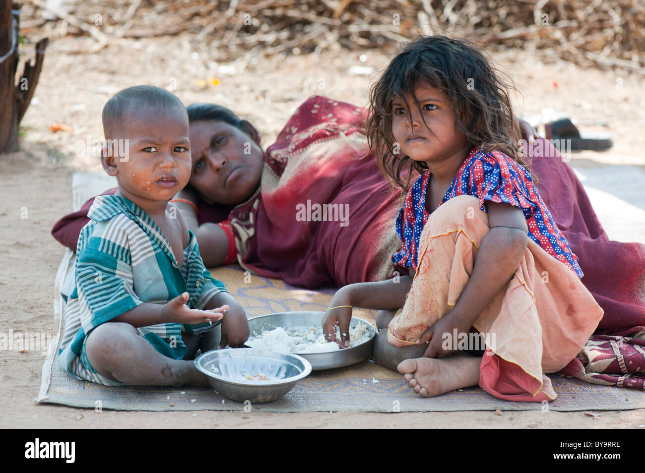 Poor lower caste Indian mother and children eating rice ...