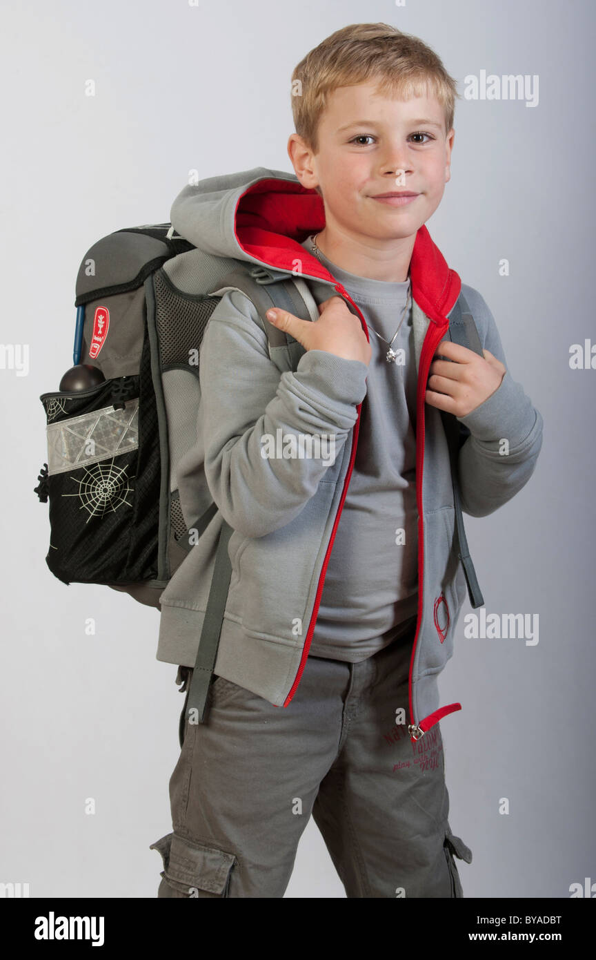 School bag for year 7 - 6 Year Old Boy With A School Bag First Grade School Child Stock Photo