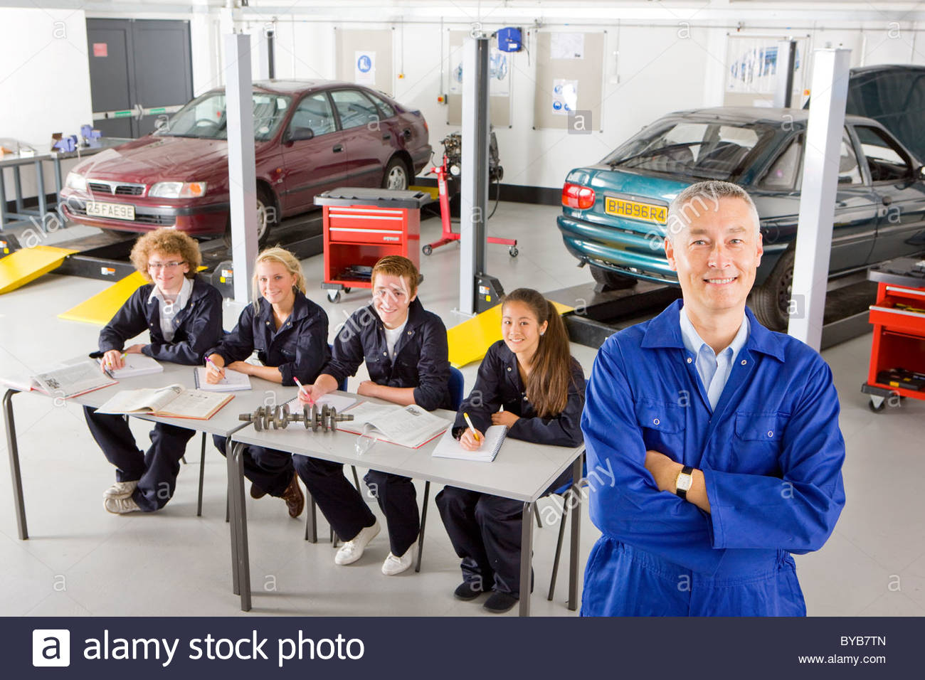 teacher students studying automotive trade in vocational stock photo teacher students studying automotive trade in vocational school