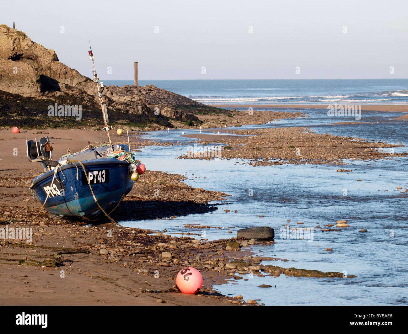 Fishing Boat At Low Tide Bude Cornwall Uk Stock Photo
