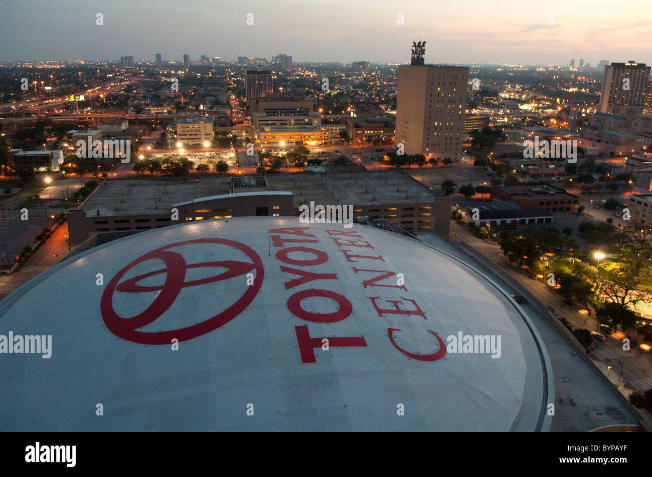 Skyline of downtown houston texas usa showing roof of toyota center arena home