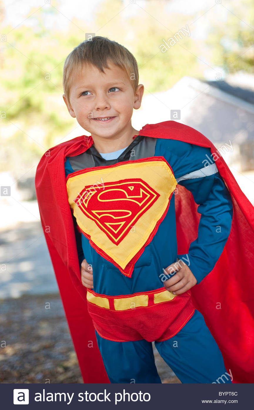 4 Year Boy Bedroom Decorating Ideas: A 4-year-old Boy Is Dressed Up In A Superman Costume For
